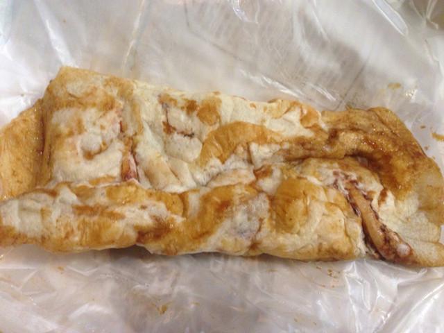 廻転いか焼 天六屋 - ¥150のいか焼き ソース味