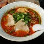 30077609 - 赤いスープが特徴のスタミナラーメン
