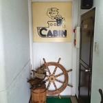 珈琲艇キャビン - 地下一階のお店の入り口 ポパイがお出迎え♥︎