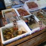 網走感動朝市食堂 - 牡蠣やイカも売ってます、さすが市場ですね。