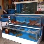泳ぎ活魚・炭火焼き 駅前 -