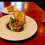 31016469 - 前菜+パスタのセット(2,200円)の前菜:鯵と茄子のタルタル。奥に写っている自家製フォカッチャも一緒に供されます。