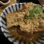 31100520 - 肉豆腐は、厚揚げ煮物に鶏そぼろが乗ってます。