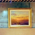 キャトル・セゾン - 壁面の絵画。