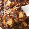 上海ダイニング - 料理写真:シェフの自信作「黒の麻婆豆腐」。自家製豆鼓のコクとラー油を控えたヘルシーな一品。