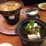 川太郎 - 晩酌セットの湯豆腐に、単品注文の牡蠣みそ鍋(950円)。