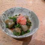 心寿司 - お通し(ニシ貝の肝もみじおろしポン酢かけ)