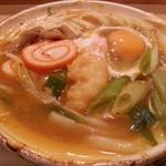 八兵衛 - 料理写真:モツ煮こみうどん 卵入り