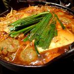 32784303 - 【豚チゲ鍋】ピリか辛ダシが後を引く美味しさ。寒い夜に皆で鍋を囲んで暖まります♪
