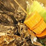 かき小屋本舗 - 牡蠣のがんがん焼き