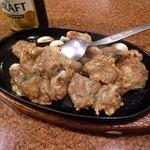 慶福楼 - にんにくを生かした海鮮鉄板焼(冬季:牡蠣)