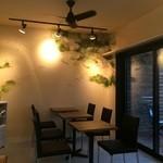 33495965 - カフェスペース。壁の絵は手描きだそうで素敵でした(*´∪`)