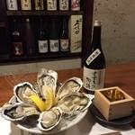 牡蠣三味 - 北海道のすすきの物語がおいてある