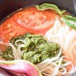 33660518 - お野菜たっぷりトマトつけ麺 990円 のつけ汁の中のつけ麺