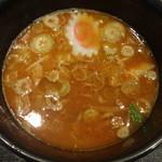 大勝軒まるいち - 辛つけ麺のスープ
