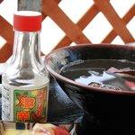 読谷村漁業協同組合 海人食堂 - いか墨汁(コーレーグースで一段と美味しく)