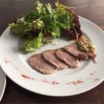33863418 - サラダ付き前菜。しっとり仕上げた国産豚の舌。                       初めて頂きましたが、違和感なく美味しい♪