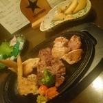 ととら - 鶏のオールスター焼М、お造り三種、アンチョビポテト(食べかけです)
