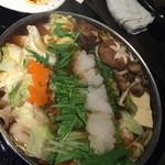 33945938 - 冬季限定みぞれ鍋。ダイコンおろしと野菜たっぷりモツ鍋。
