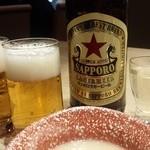 34039870 - 赤星ラガービールと本日のお通し(シチュー)
