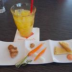 34322294 - ランチの前菜とオレンジジュース
