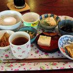 34513755 - 朝食は小皿を取っていく方式。お豆腐の横にあるのが伝統料理「へしこ」