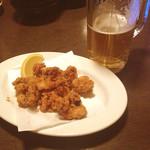 えこひいき - たこの唐揚げ/生ビール