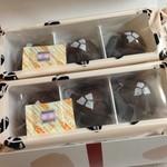 34836506 - 灸まんの形をしたチョコ風味のお饅頭が、3個入り2パック入っています