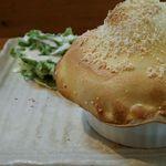 34917747 - 季節限定のチキンのチリトマトクリームソースパイ包み焼き