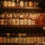 ホルモン酒場 焼酎家「わ」 - 棚の焼酎 隣の棚は梅酒がメイン?