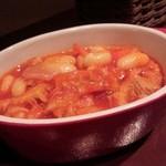 35190299 - お通し トリッパのトマト煮込み(お代わり自由)