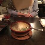 35204531 - 〆の雑炊(+300円)                       席でチーズを摩り下ろしてもらいます。