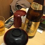 35241081 - お椀とヱビスビール中瓶。