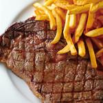 ヌガ - ステーキフリット  リブロースステーキにフレンチフライを添えて。ビストロの定番です。