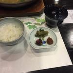 35319147 - ごはんと奥に金目鯛のお煮物と、手前に香の物。                                              カラヤンが美味しかった〜