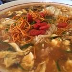 薬膳 天地・礼心 東方人康食養館 - ジャンキーさは無く柔らかな酸味に溶き卵がますます柔らかな味わいにしてくれます。