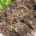 東大門 - スンデ。                             豚の血入りの腸詰です。                             中にお米が入ってるのが珍しい。