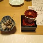 35611109 - 白バイ貝のお通しと獺祭純米大吟醸