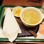 35673571 - モスの朝ライスバーガー 朝御膳「たまご 黄身醤油ソース」                         卵かけご飯をイメージしたライスバーガーに、豚汁とつぼ漬けをセットにしました。                         \400 317kcal                         ドリンクセット ¥520