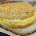 35673575 - モスの朝ライスバーガー 朝御膳「たまご 黄身醤油ソース」                         卵かけご飯をイメージしたライスバーガーに、豚汁とつぼ漬けをセットにしました。                         \400 317kcal                         ドリンクセット ¥520