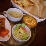 カトマンドゥカリーPUJA - カレーはマイルドで食べやすいです、辛さも調整してくれます