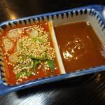 35795149 - 鯉のあらいの秘伝のタレは、味噌ベースにコチジャンと白ゴマ、ネギのとても辛いタレと、ピリッと甘辛いタレ の 2種類が用意されています。