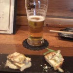 KO-KU - 料理写真:つきだしと半分飲んだビール