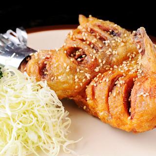 インパクト大のボリュームメニュー『ターザン焼』(ひな鶏半身)