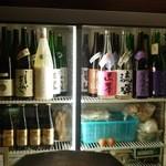 36287886 - 冷蔵ケースのお酒たち