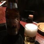 博多もつ処 煌梨 - 瓶ビール 520円
