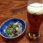 かそり - 料理写真:お通しのベーコンと緑の葉っぱ