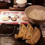 36461229 - 餃子セット200円 ご飯と餃子3つ