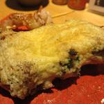 博多トク・トク 焼鳥いっせい - ニラ巻。 ニラを豚バラで巻いて焼いた後に、溶き卵をからめて更に焼いたもの。