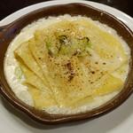 チェント アンニ ギンザ - タレッジオチーズとポロネギのラビオリアペルト
